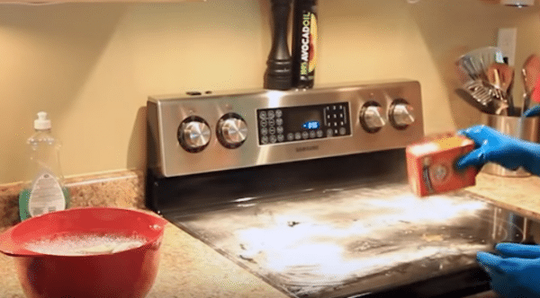 clean glass stovetop with baking soda